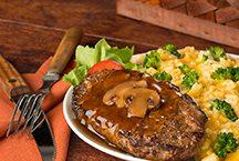 image of Salisbury Steak meal with broccoli rice