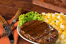 image of Western Charbroil meal ( steak with cheesy potatoes)